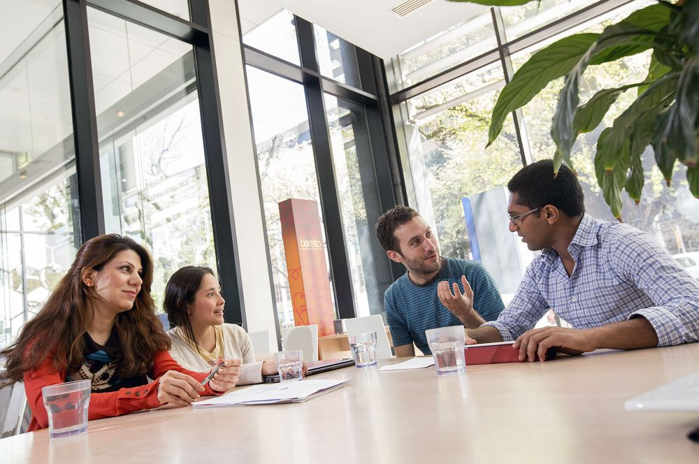 Research students talking in a cafe