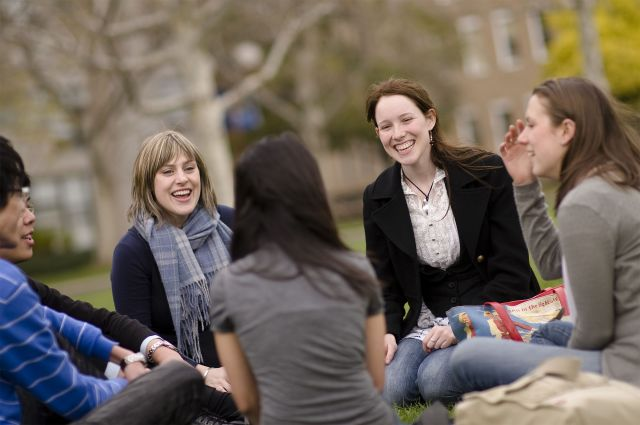A group of students chatting on South Lawn.